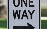 One-way sign, white with black letters